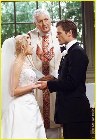 Jessica Dunphy as Alison and Bailey Chase as Chris at the characters' wedding.